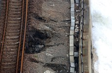 Sinkholes appear beneath train track in England as seawall begins to collapse