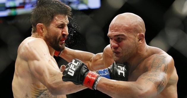 Lawler survives epic Condit contest to retain his UFC title via split decision