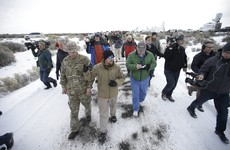 "Armed militia refuse to leave government property after men they were ""defending"" hand themselves in"