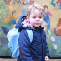 Britain's Prince George looks only delighted on his first day at school