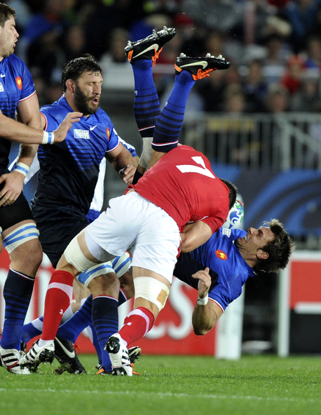 Wales' Sam Warburton tackles France's Vincent Clerc to earn his red card.