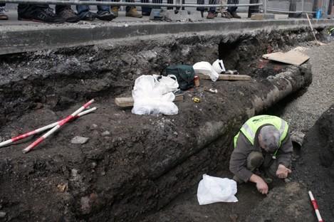 Archaeologist Franc Myles excavating the adult bones yesterday