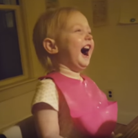 This adorable little girl finds the very concept of snow laughable