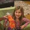 This daring little girl used a Nerf gun to pull out her loose tooth