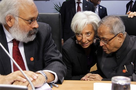 IMF head Christine Lagarde talks to India's Finance Minister Pranab Mukherjee, right, next to Reserve Bank of India deputy Governor Subir Gokarn during the G20 finance meeting in Paris on Saturday.