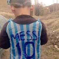 The internet is desperate to find this kid in a plastic bag Messi shirt