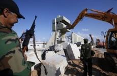 Libyans bulldoze Gaddafi's Tripoli compound