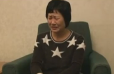 North Korean defector returns home and tearfully tears up her memoir