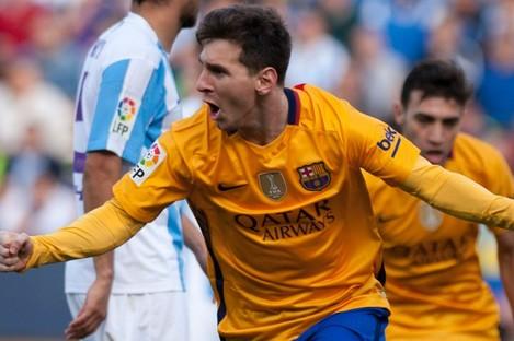 Barcelona's Lionel Messi celebrates his goal at Malaga