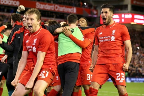Liverpool players celebrate winning the penalty shootout.