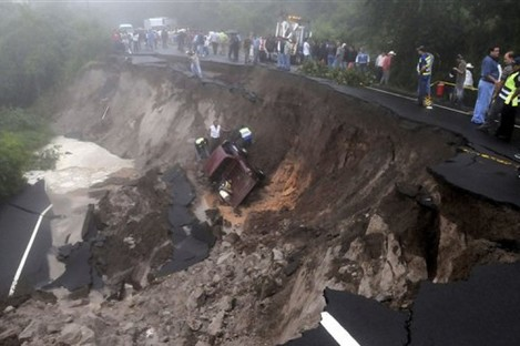 A landslide caused by heavy rains at the Pan American an highway La Cuesta de la Moramulca, 52 Km. from Tegucigalpa, Honduras, Monday, Oct. 17, 2011.