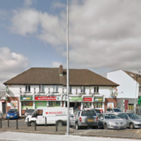 Shop worker injured after robbery at knife-point