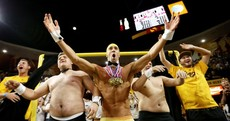 What is Michael Phelps doing in a pair of gold Speedos at a basketball game?
