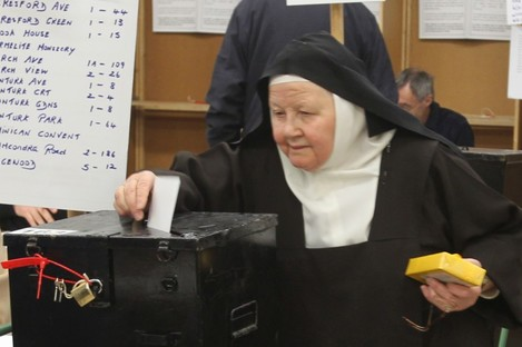 A nun casts her vote in the 2011 general election