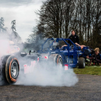 Ever wondered who'd win in a fight between an F1 car and a rugby pack?