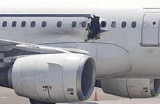 Man 'sucked out of plane' after explosion
