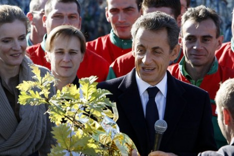 A proud Pappa: French President Nicolas Sarkozy receives an oak tree, as a gift after the birth of his daughter.