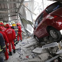 10-day-old baby among five killed as powerful earthquake brings down apartment complex