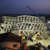 Photos: Race to free 120 people still buried under rubble