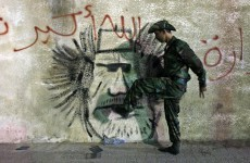 Gaddafi's body being kept in shopping centre freezer