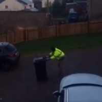 This guy's attempt at putting out the wheelie bin is the epic struggle of our time