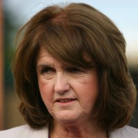 Joan Burton defends Labour TD pictured with Gerry Hutch