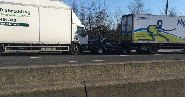 Three trucks crashed on the M50 and a car was caught in the middle