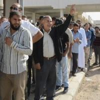 Autopsy reveals Gaddafi died by gunshot to head