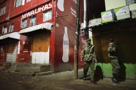 Kenyan police guard the scene of today's grenade attack at a Nairobi nightclub.