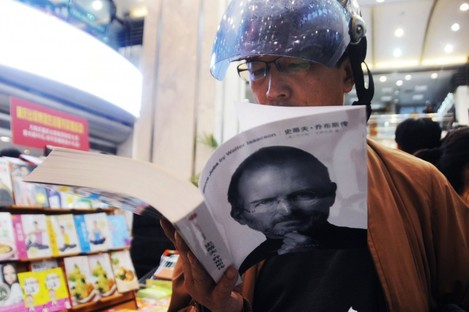 A customer reads the new biography in a Shanghai bookstore