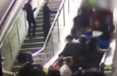 Watch the moment that an escalator reversed and caused a huge pile up