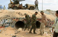 Libya: official says Gaddafi was buried at dawn