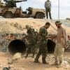 Libya: official says Gaddafi was buried at dawn