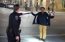 Angry crowds rally after police officer 'shoots teenager carrying broomstick'