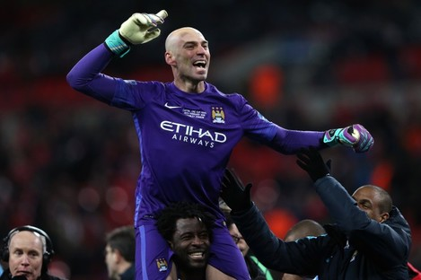 Caballero is hoisted onto the shoulders of team-mate Wilfried Bony.