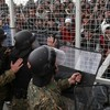 Tear gas fired as migrants try to storm Greece-Macedonia border fence