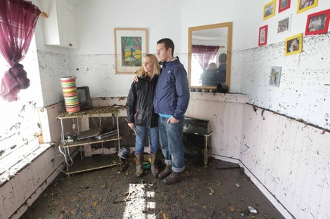 Georgina and Mike Culshaw survey the damage in their Kilmainham home yesterday morning