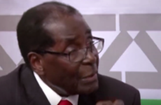 92-year-old Robert Mugabe just threatened to punch a journalist