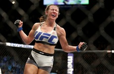 Miesha Tate chokes out Holly Holm to win the UFC women's bantamweight title