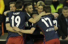Torres on target as Atleti keep title hopes alive with win against Neville's Valencia