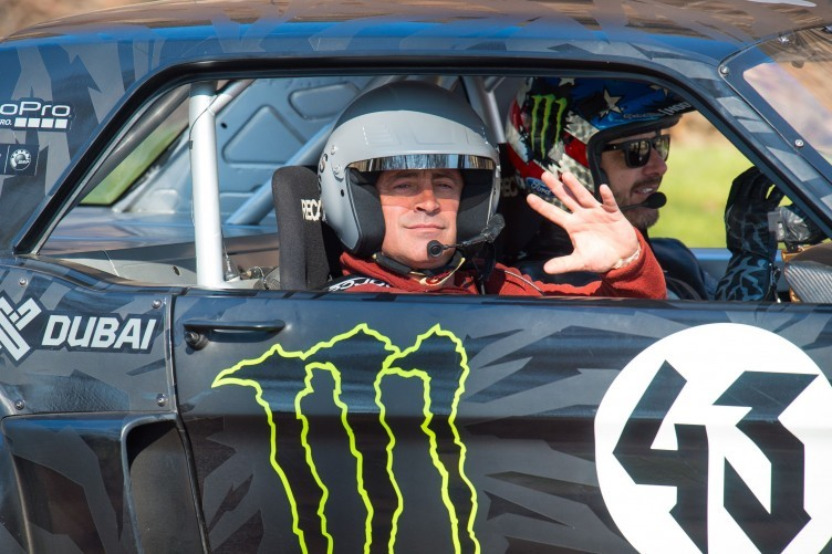 Actor and Top Gear presenter Matt LeBlanc, left, waves , as he sits with rally driver Ken Block during filming of BBC Top Gear in Westminster, London on Sunday