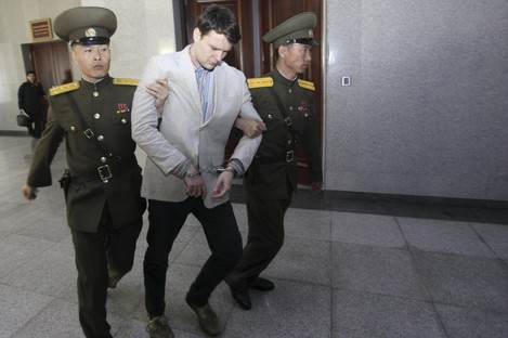 Otto Warmbier is escorted at the Supreme Court in Pyongyang.