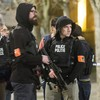 Manhunt for terrorist suspects continues as Islamic State flag found at scene of shootout
