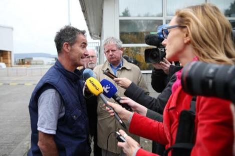 A Lufthansa Technik worker speaks to media in 2013.