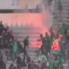 2 dead and 54 injured as fans clash at football stadium