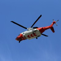 Three fishermen rescued by helicopter after boat capsizes in sea