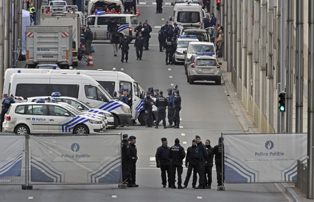 Police secure the metro station Maelbeek in Brussels.