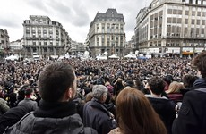 A minute's silence in Brussels was ended with defiant applause