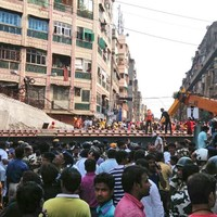 At least 20 dead as bridge collapses on crowds in India