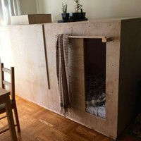 Man can't afford to live anywhere - builds bedroom 'pod' in someone else's apartment
